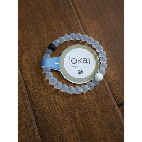 The Hottest selling bracelet is the Lokai Bracelet. It contains water from Mt. Everest and Mud from The Dead Sea.  Free Shipping!