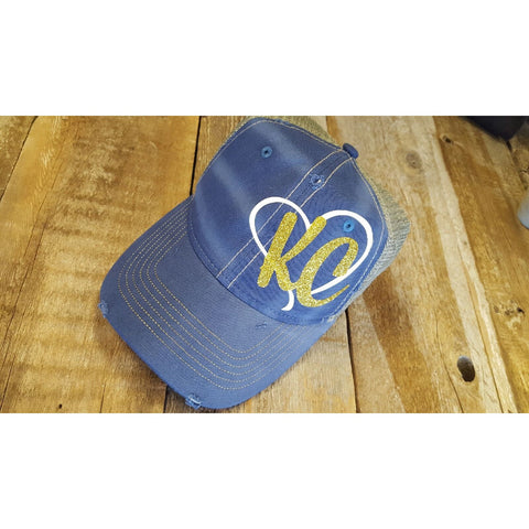 KC Blue hat w/ white heart (Gold)