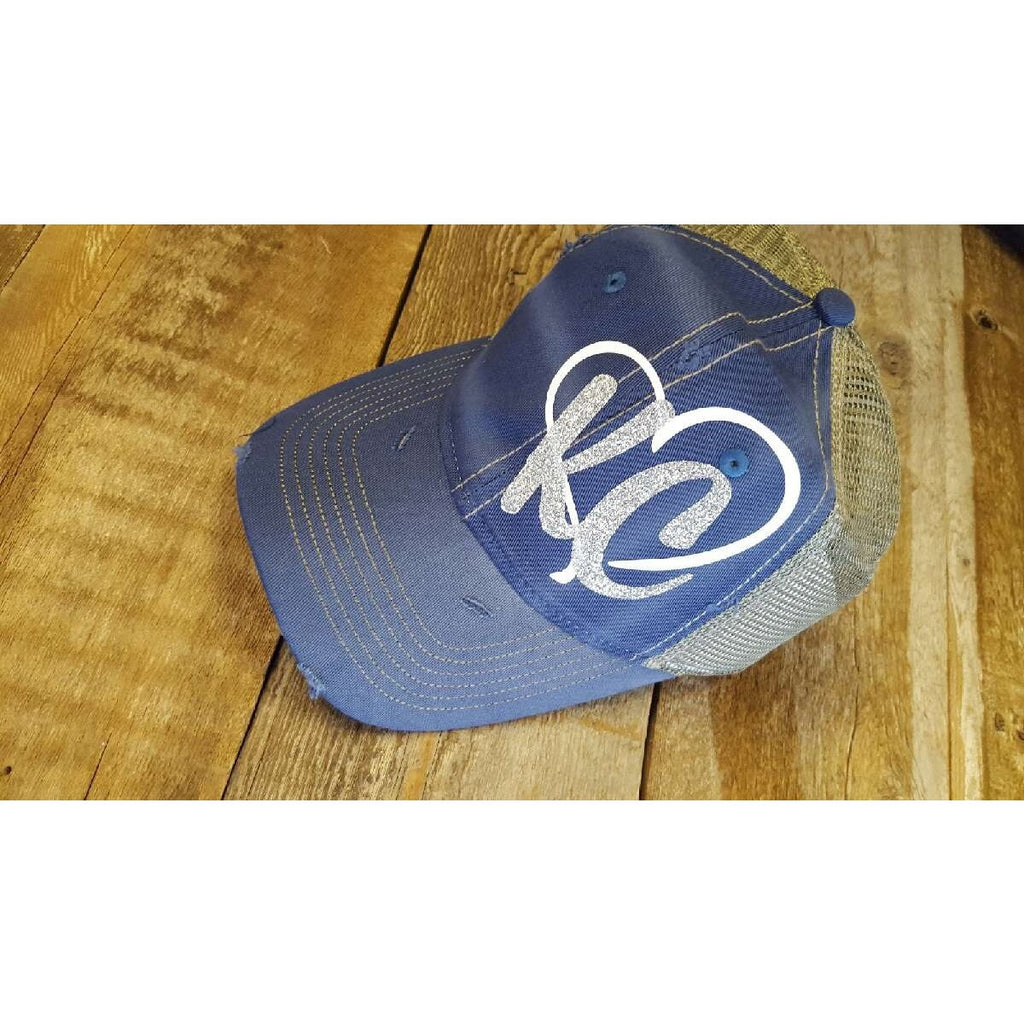 Blue distressed hat with silver KC and a white heart! Show your KC pride with this cute hat. Adjustable