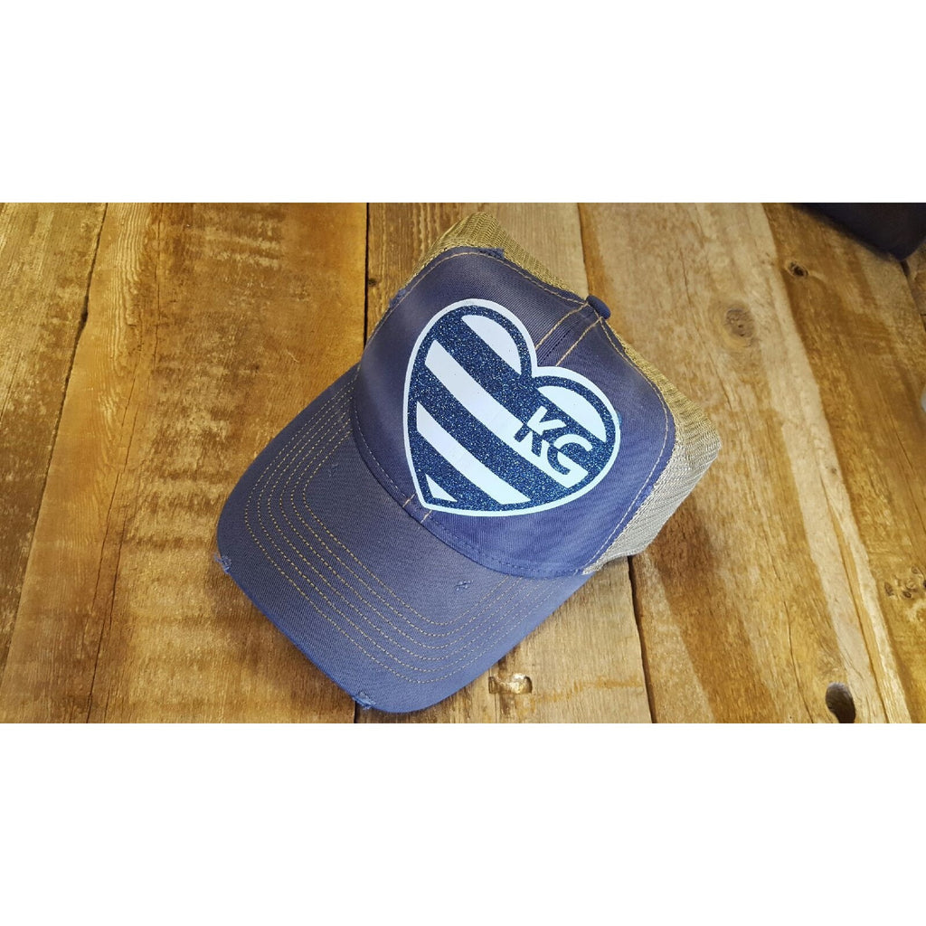 Blue distressed hat with striped KC heart! Show your KC pride with this cute hat. Adjustable