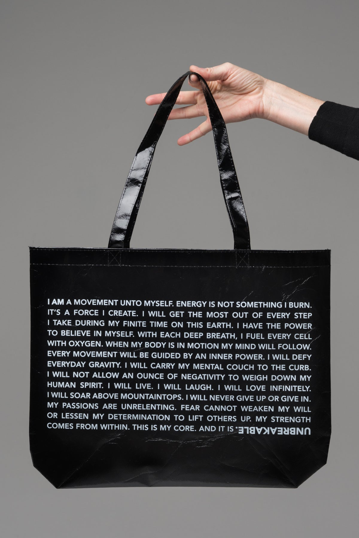 UNBREAKABLE. Laminated Tote Bag