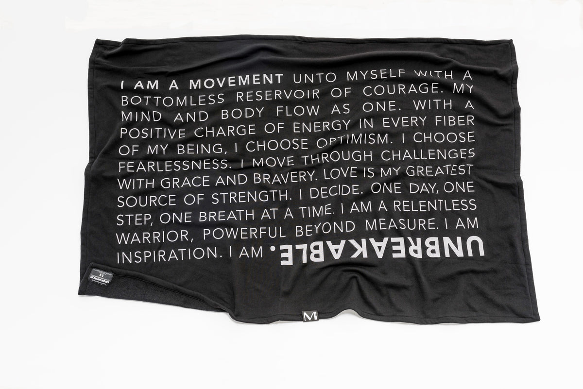 Extra soft, polycotton blended fleece blanket with UNBREAKABLE manifesto. Black.