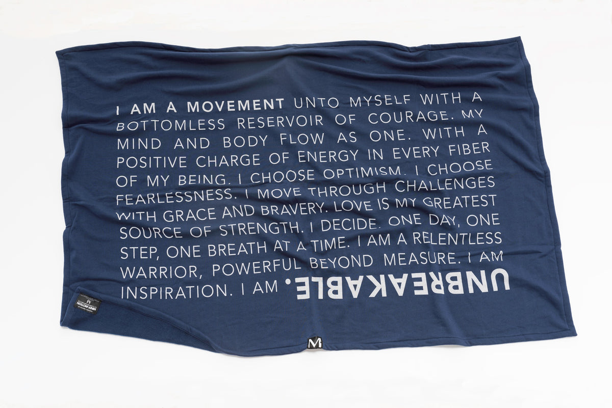 Extra soft, polycotton blended fleece blanket with UNBREAKABLE manifesto. Navy..