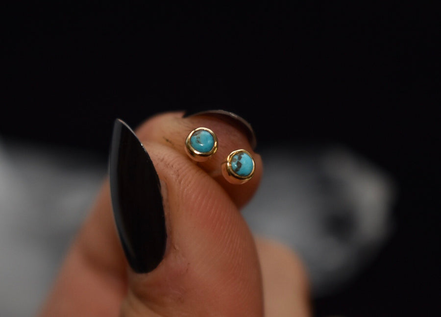 Turquoise and gold mini studs.
