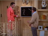 The Odd Couple. Futuristic Clock. https://www.mondomonsterwear.com/products/odd-couple-futuristic-clock A classic episode of The Odd Couple, had Felix Unger redecorate the apartment with all sorts of funky modern furniture like hand chairs and dot clocks. Shirt