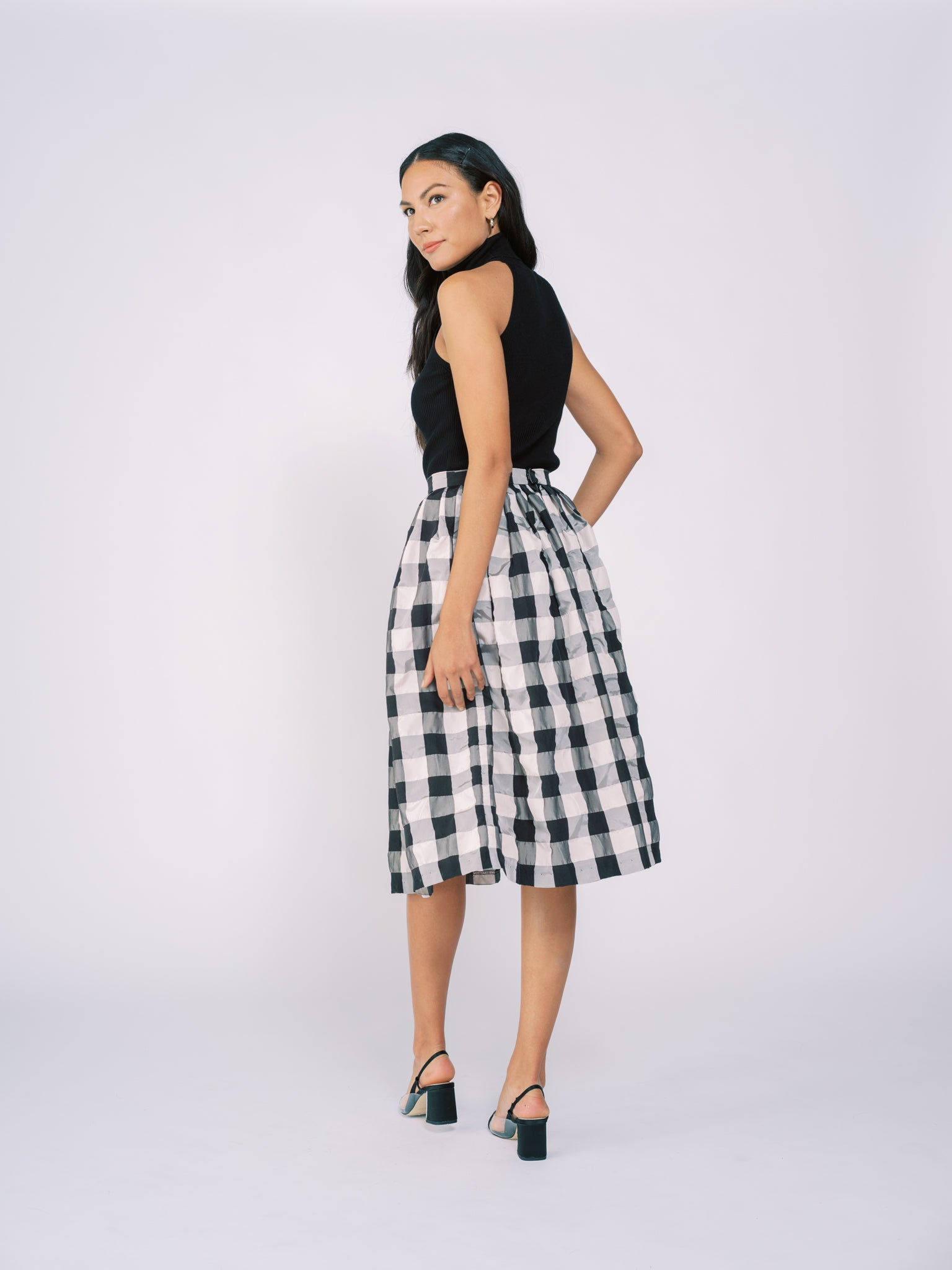 Pleated Midi Skirt in Black and White Checkered Pattern
