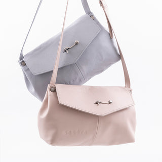 Pale pink cross body bag