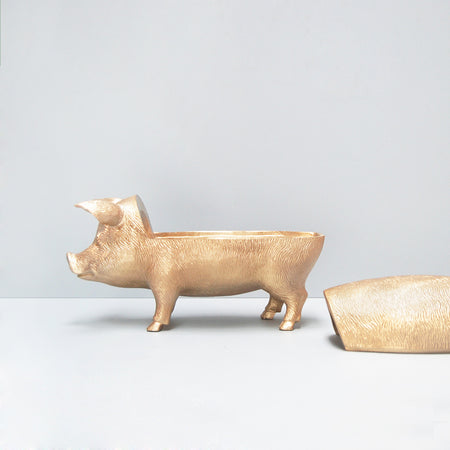 Gold resin secret pig bowl by White Moose from the homewares and home decor 2019 collection. Images shows lid off