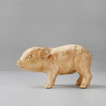 Gold pig money box. Piggie bank. Seen on the block 2017