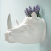 Wall mounted rhinoceros head in white resin to decorate the home and office. Home decor animal head is quirky and great for kids decor.