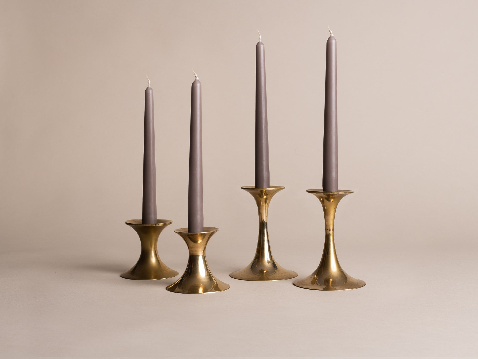 "Suite de 4 flambeaux modernistes, Danemark (vers 1955)..Set of 4 ""Diabolo"" modernist Candle holders Denmark (circa 1955)"