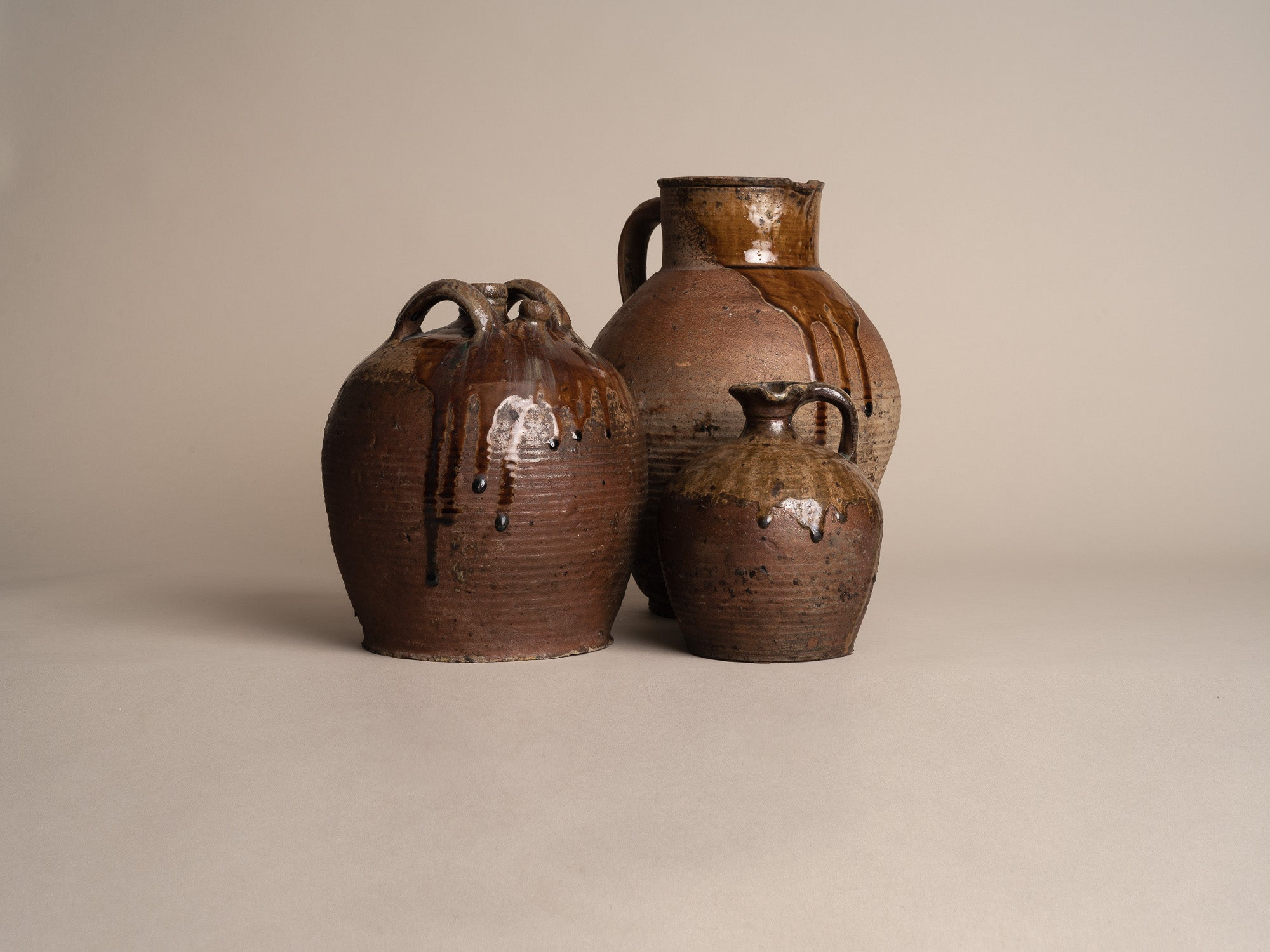 Ensemble de pots en grès de Puisaye, France (XVIIIe et XIXe siècles)..Set of stoneware folk pots by anonymous Puisaye potters, France (18th & 19th century)