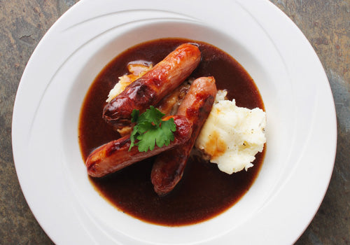 Sausages, mash and red onion chutney gravy