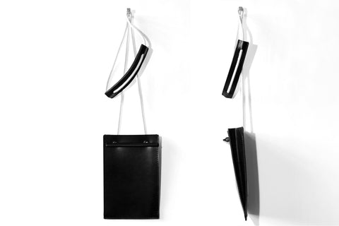 TRAVEL SLING IN BLACK