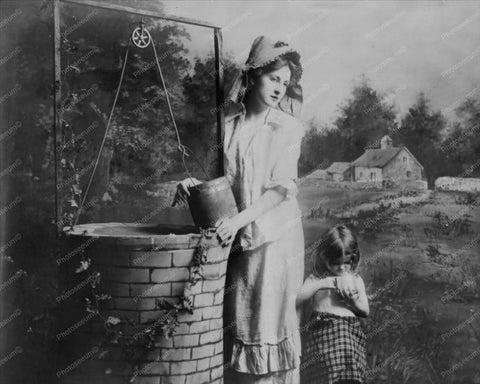 Victorian Lady At Well With Small Child  8x10 Reprint Of Old Photo