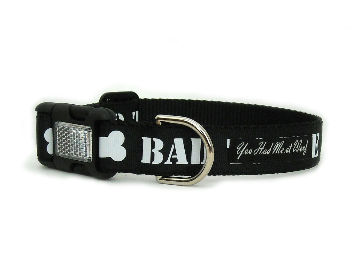 The Bad to the Bone Dog Collar in all black with bold white letters displaying the words, Bad to the Bone.