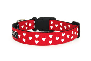 Back side of the Be My Valentine Dog Collar in red, displaying the pattern repeating itself along the length of the collar