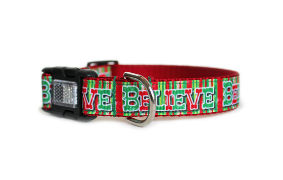 The Believe Dog Collar with red, white, and green vertical stripes and the text, Believe in bold green and red letters.