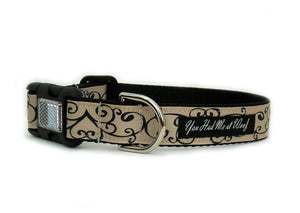 The Bella Dog Collar in beige with black swirly hearts that repeat along the length of the collar.