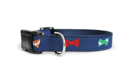 The Bow Ties Dog Collar, navy blue with bow ties in green, blue, orange, and red, which reapeat along the length of the collar.