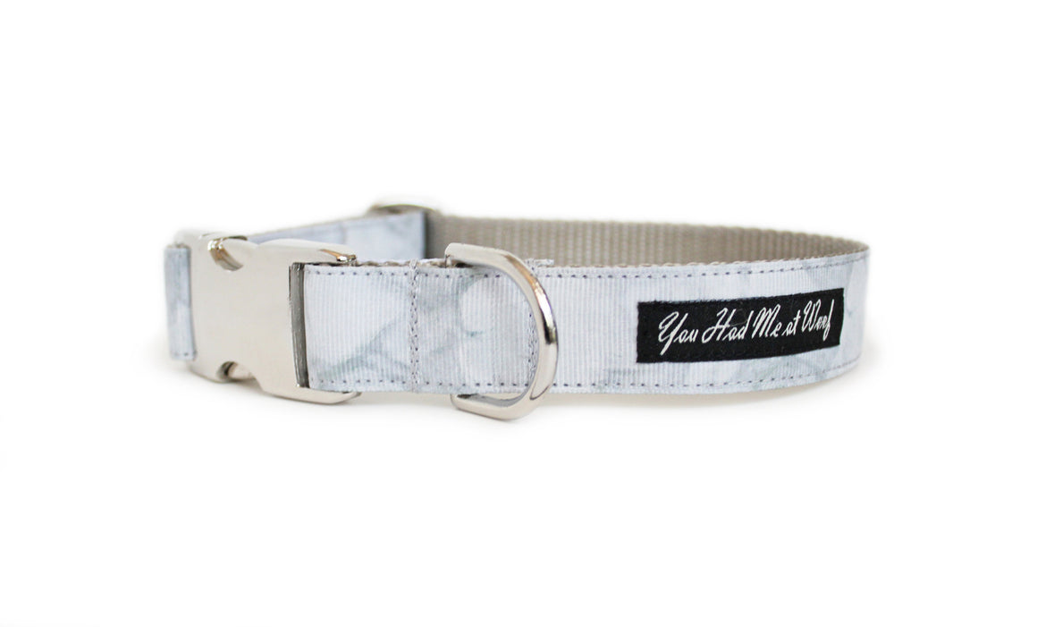 The Carrara Marble Dog Collar, with its smooth texture and life-like gray veining.