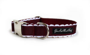 The Collette Dog Collar in burgundy with white lace trim peeking out on each side.