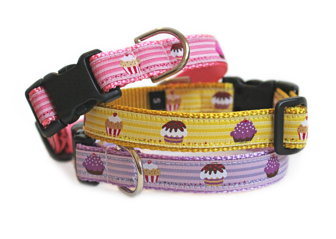 The Cupcakes Dog Collar, shown in three color options, pink, yellow, and purple, with cute cupcakes repeating down the length of the collar.