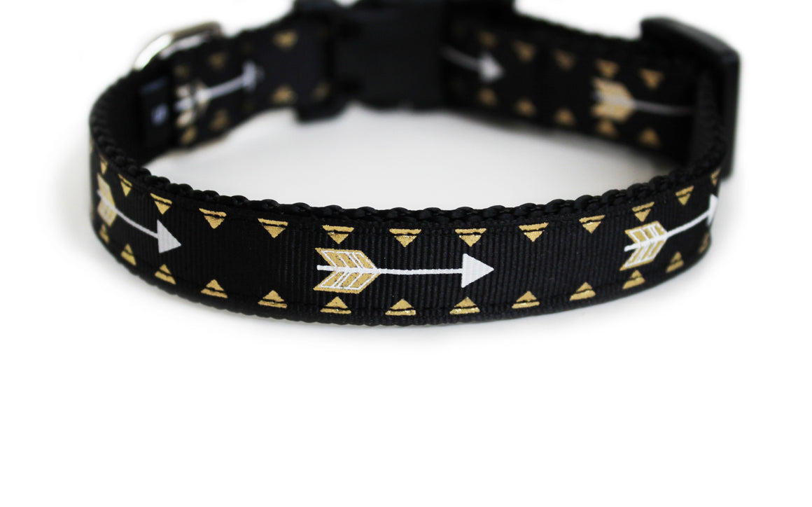 The Cupids Arrow Dog Collar in all black with golden arrows that repeat along the length of the collar.