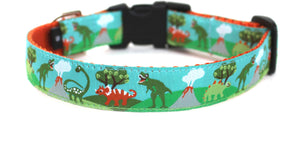Dinosaur Dog Collar with T-rex, Triceratops and Stegosaurus with a background of volcanoes, green hills and blue sky