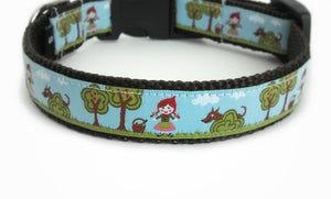 Little Red Riding Hood Dog Collar with Little Red Riding Hood in the woods as the Big Bad Wolf watches her from behind a tree