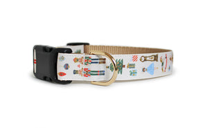 The Nutcracker Dog Collar in cream with gold glittering Nutcracker ballet characters, presents, ornaments, and a Christmas tree.