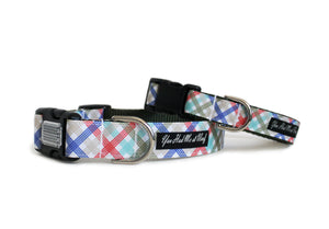 Plaid Preppy Dog Collar in crisp blue, green and red atop a white backdrop.