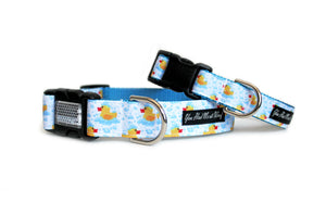 The Rubber Ducks Dog Collar with cute yellow rubber ducks floating in light blue bubbles.