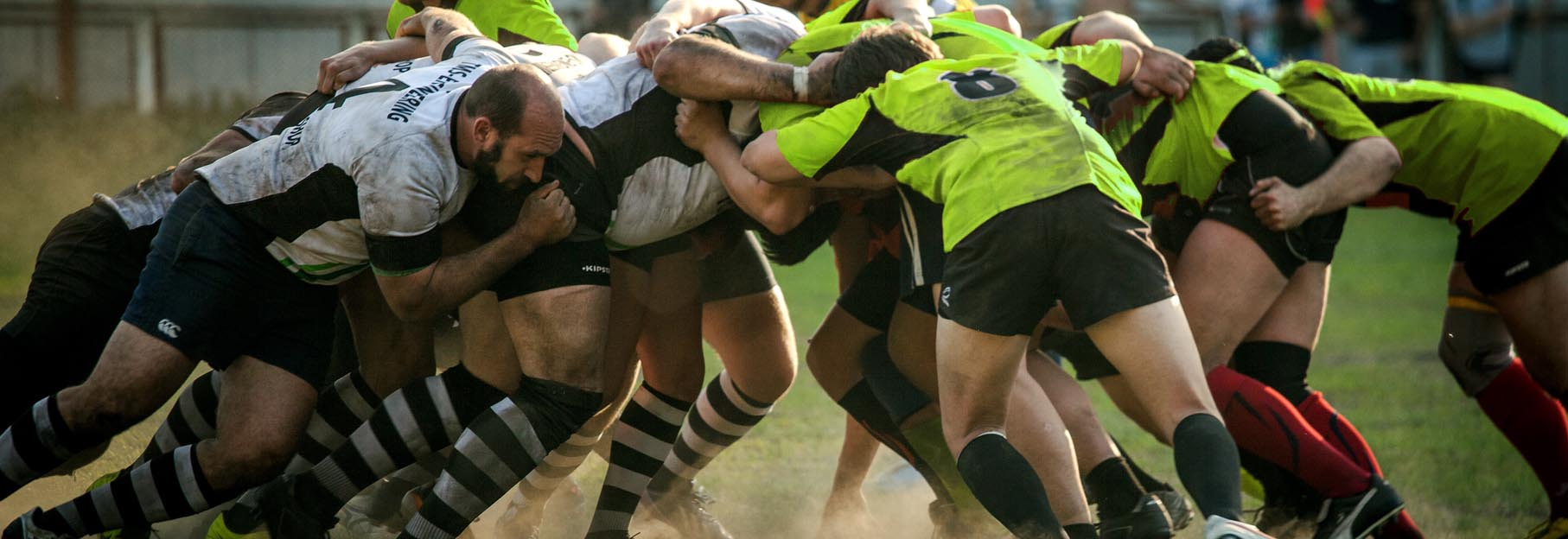 rugby players wearing a mouthguard during a game