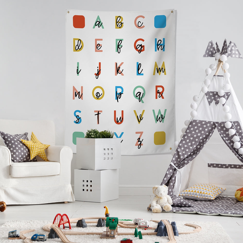large alphabet wall hanging in child's playroom