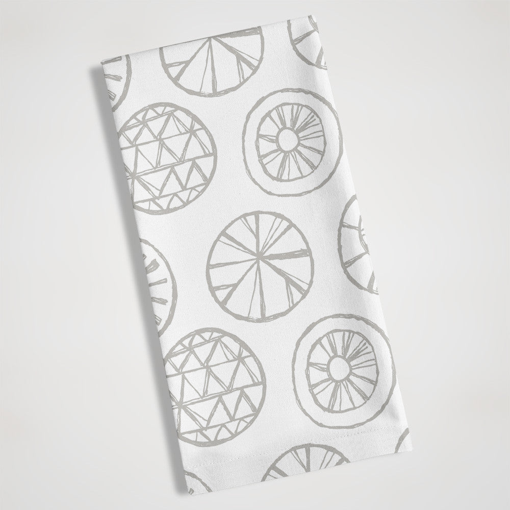 gray and white hand carved circles tea towel