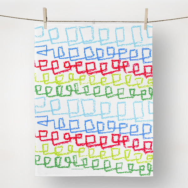 Hanging view of hand-drawn tea towel, red, green, blue.