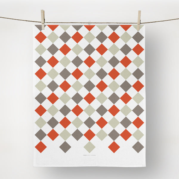 diamonds in gray, and warm orange tea towel