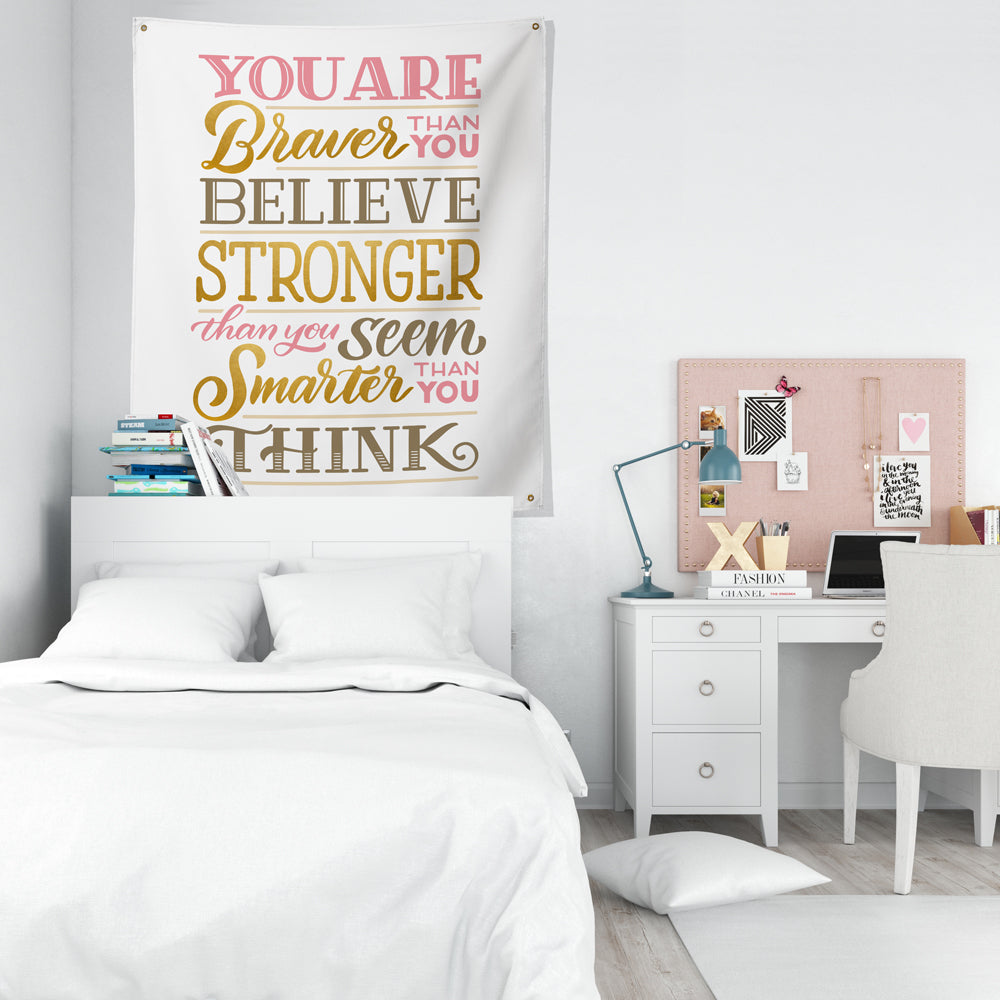 braver stronger and smarter than you think tapestry above bed