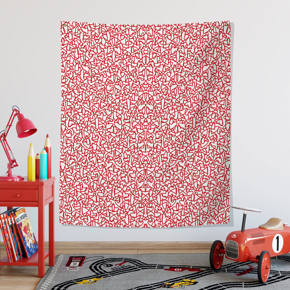 red hearts wall tapestry hung in a child's playroom