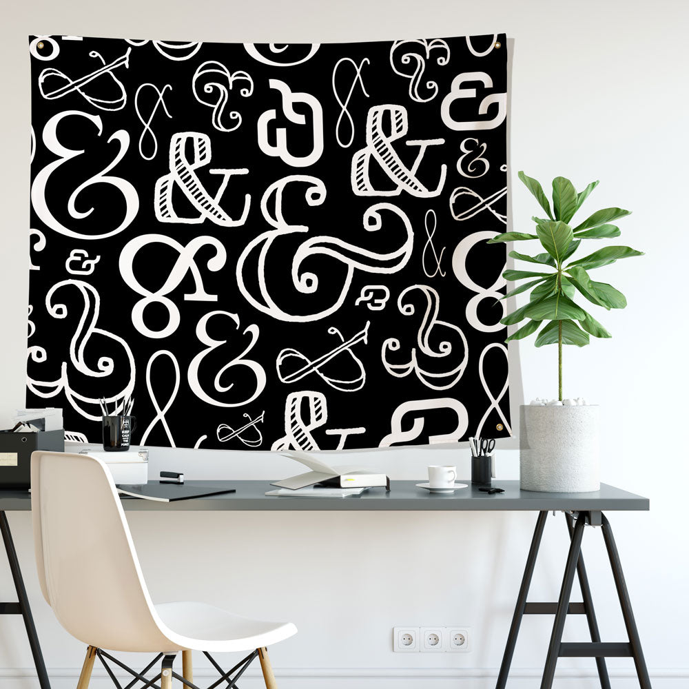 ampersand mostly black wall tapestry hung in an office