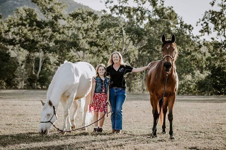 family photo featuring survivor of equestrian accident