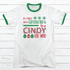 IN A WORLD FULL OF GRINCHES Premium Christmas Ringer Tee