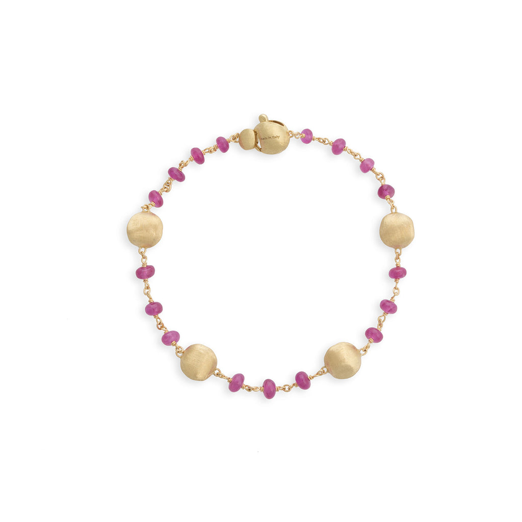 Africa 18K Yellow Gold and Ruby Single Strand Bracelet