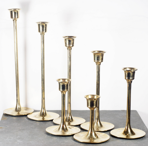 Set of Seven Graduated Brass Candlesticks