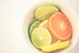 Citrus on White - Vibrant Fruit Photograph Print