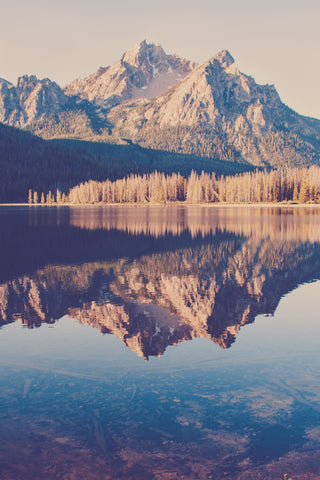 McGown Peak stands above Stanley Lake, with the reflection of the mountain in the still lake water.  Nature fine art photograph by Jessica Torres.