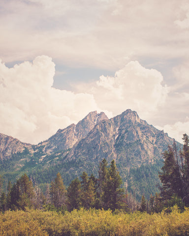 Photography Print of McGown Peak in the Sawtooth Mountain Range near Stanley, Idaho.  Summer sky above the mountain top, and green pine trees below the mountains.