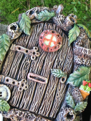 stunning fae door with plant