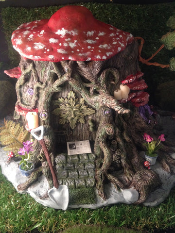 large detailed fairy home with newspaper